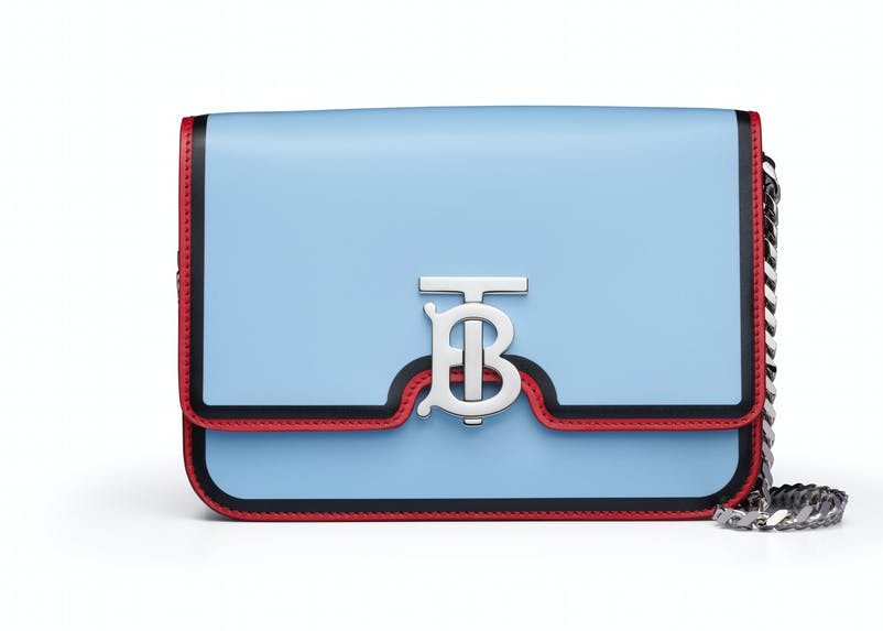 Pale blue TB bag with red trim and chain strap (1).jpg