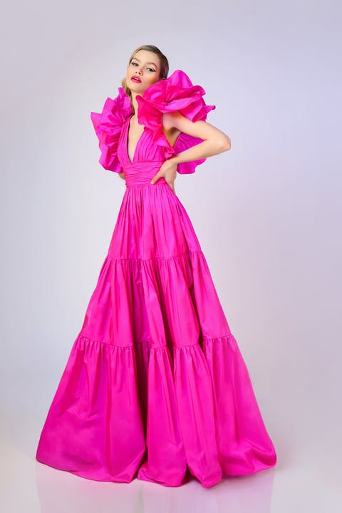 Fuchsia taffeta evening gown featuring ruffled shoulder detail, tiered skirt and plunge neckline.