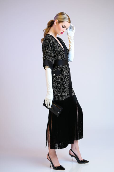 Black liquid velvet belted kimono featuring crystal embroidery and silk fringing. Black alligator lisse Jolie clutch with black patent sling backs.