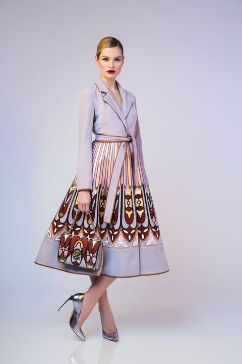 Mauve 'Cathedral' print nappa leather belted coat. Mauve 'Cathedral' print flap shoulder bag with glycine Empire pumps.
