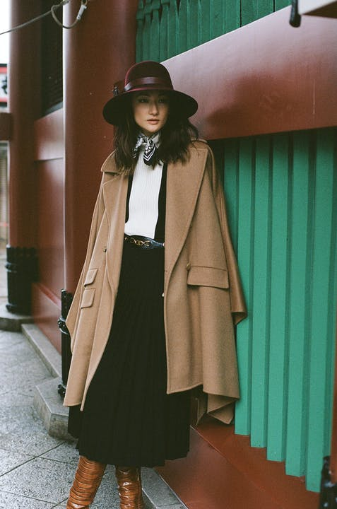 Poncho, Belt and Boots, MAX MARA. Dress, CELINE. Hat, HELEN KAMINSKI.