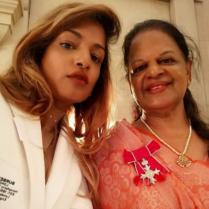MIA-accepts-MBE-withmother-rapperMIA-royaltitles-celebrityroyaltitle.jpg