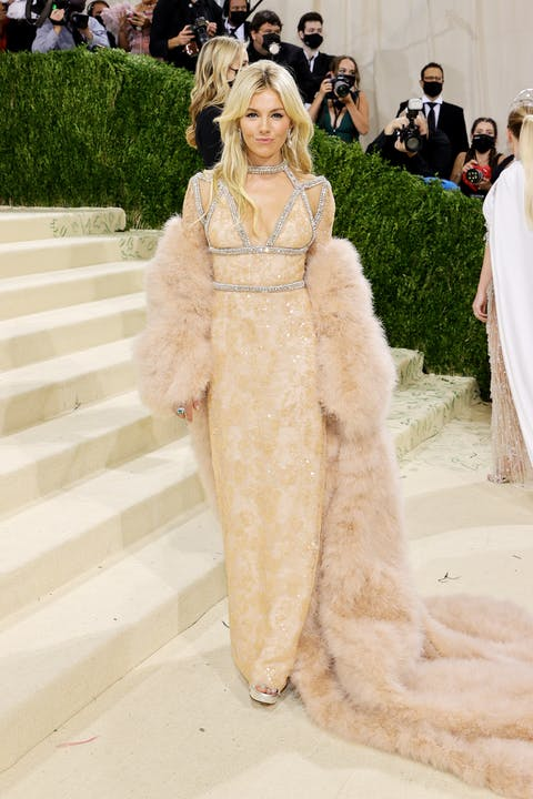 Sienna Miller wears a blush Gucci dress and coordinating feathered jacket..jpg
