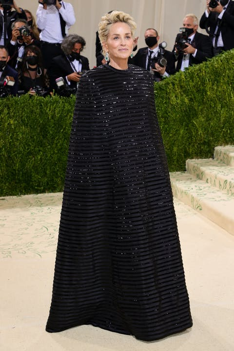 Sharon Stone is in a Thom Browne look inspired by a dress Browne's own mother once wore.jpg